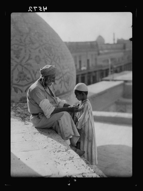 Iraq. (Mesopotamia). Baghdad. Views, street scenes, and types. Age instructing youth in Haidar Khana Mosque