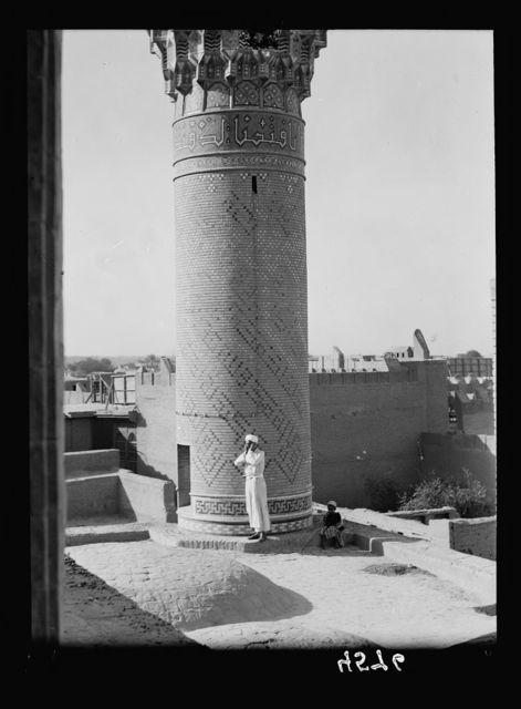 Iraq. (Mesopotamia). Baghdad. Views, street scenes, and types. Lower section of the Haidar Khana Mosque. Muezzin calling to prayer