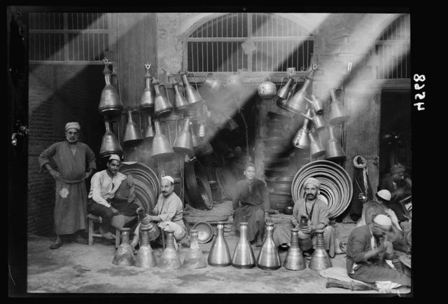 Iraq. (Mesopotamia). Baghdad. Views, street scenes, and types. Typical copper store with jugs and trays