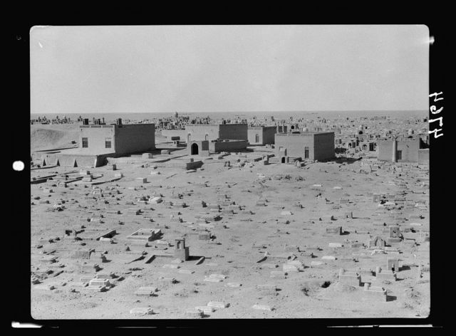 Iraq. Nejaf. First sacred city of the Shiite Moslems [i.e., Muslims]. The necropolis showing graves of poor in foreground. No monuments, mere head stones