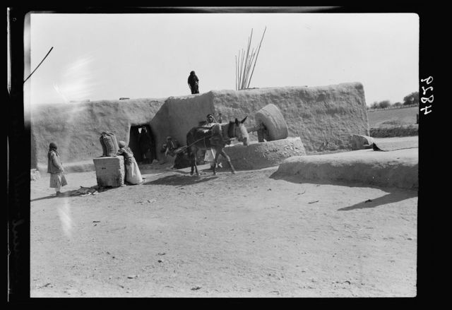 "Iraq. Nineveh. ""The Glory of Kingdoms."" A primitive wheat mill near shrine of Nebi Yunis"