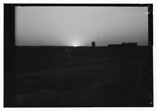 Iraq, oil fields, sunrise or sunset near installation