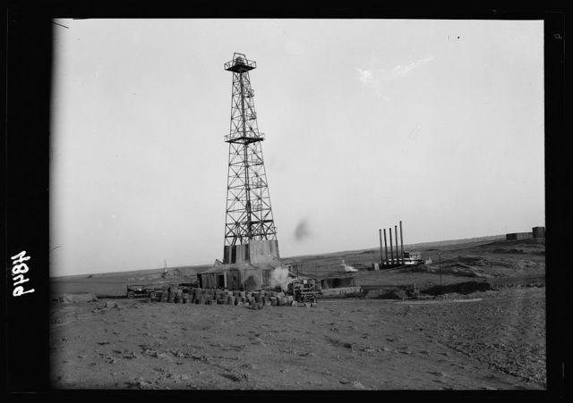 Iraq. Oil wells and camp of the Iraq Petroleum Company. (5 miles S. of Kirkuk). Kirkuk District. An oil driller. Showing full height of drill tower