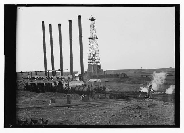 [Iraq. Oil wells and camp of the Iraq Petroleum Company. (5 miles S. of Kirkuk). Kirkuk District. An oil driller. Showing full height of drill tower]