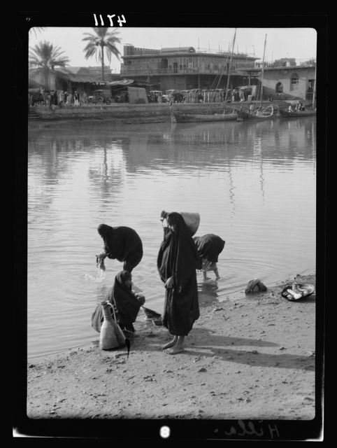Iraq. River scenes on the Euphrates taken at Hilla. Women washing clothes. And fetching water from the same spot