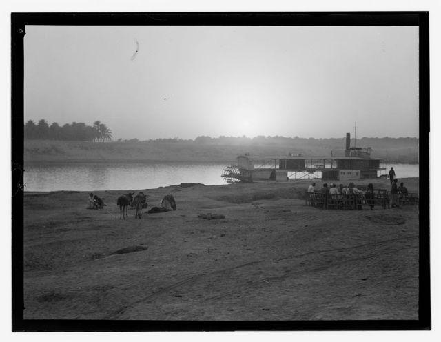 Iraq, sunset, riverboat, people & animals