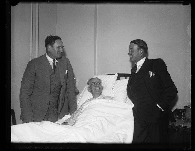 [Joseph T. Robinson? left; with man in hospital bed]