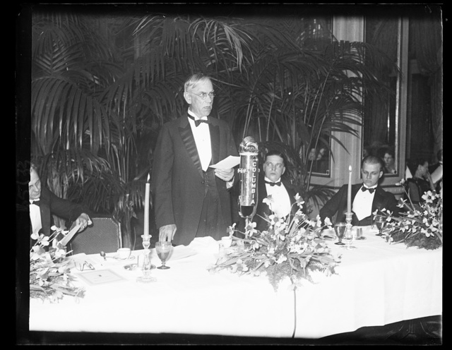 """""""Little Congress"""" holds annual dinner. Senator Reed Smoot, of Utah, speaking at the thirteenth annual dinner of the Little Congress, an association of secretaries and attaches of senators and representatives in Congress, which was held at the Shoreham Hotel in Washington. In the photograph, left to right; Senator Smoot; Rep. Paul Kvale, of Minnesota; and Rep. Carlton Mobley, of Georgia, 25 years old and the youngest member of Congress"""