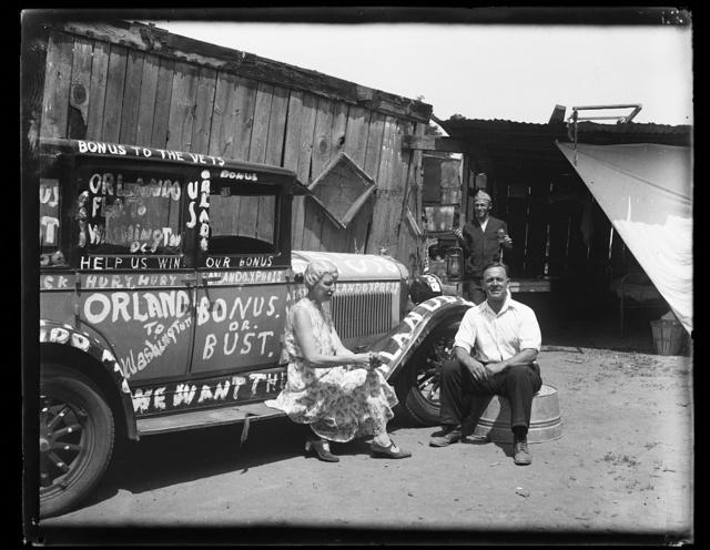 [Woman and man next to automobile: Orlando to Washington, Bonus or Bust]