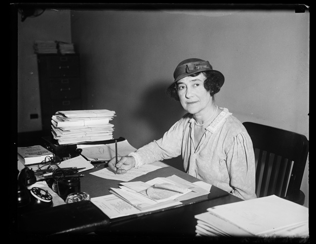 [Woman at desk in office]