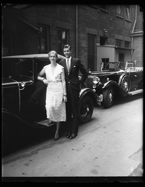 [Young woman and man at automobile]