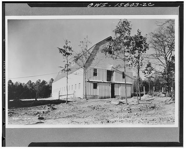 Agriculture being still the predominant occupation in the Valley, the TVA's (Tennessee Valley Authority) programs included a demonstration of good agricultural practices. The barn shown here was built in the course of such programs and served the double purpose of demonstration and the provision of pasteurized milk for construction employees