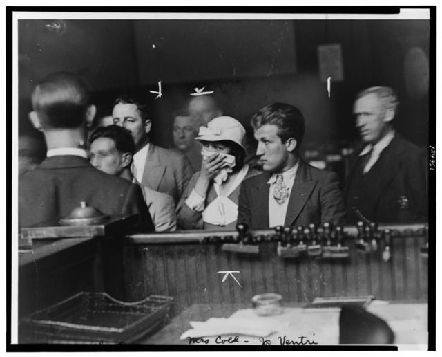 [Albert Guarino, aka Thomas Pace, (left), Lottie Coll, and Joseph Ventri standing in court, facing left]