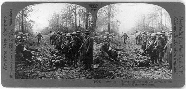 Americans escorting German prisoners to the rear, Meuse-Argonne