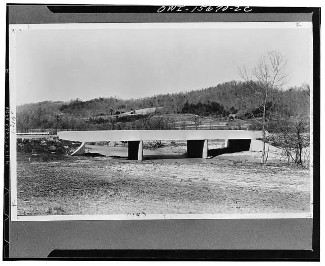 Bridges. Another bridge on the Norris freeway, designed as a continuous concrete structure, cantilevered past the abutments. The simplicity of TVA (Tennessee Valley Authority) bridges contrasts with considerable detail and ornamentation on the standard types of most state highway departments. Photograph illustrates unspoiled rural character of surroundings which was attained by purchase of broad strips of land either side of road and, further contracts with abutting land owners giving them right to cultivate TVA-owned strip in exchange for prohibiting signboards on their own property