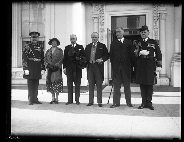 CANADIAN PRIME MINISTER ARRIVES AT WHITE HOUSE. PRIME MINISTER RICHARD B. BENNETT OF CANADA, ARRIVED AT THE WHITE HOUSE TODAY TO TAKE PART IN THE DISCUSSIONS ON THE COMPLICATED FOREIGN EXCHANGE PROBLEM. IN THE PHOTOGRAPH, L TO R: COL. JAMES ULIO, MILITARY AIDE; MRS. WILLIAM D. HERRIDGE, WIFE OF THE MINISTER FROM CANADA; MINISTER HERRIDGE; PRIME MINISTER BENNETT; PRESIDENT ROOSEVELT; AND CAPT. WALTER VERNOU, WHITE HOUSE NAVAL AIDE