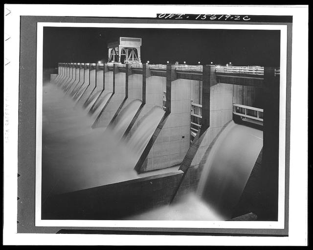 Chickamauga Dam and powerhouse. View of Chickamauga spillway floodlighted at night from visitors' overlook terrace at powerhouse