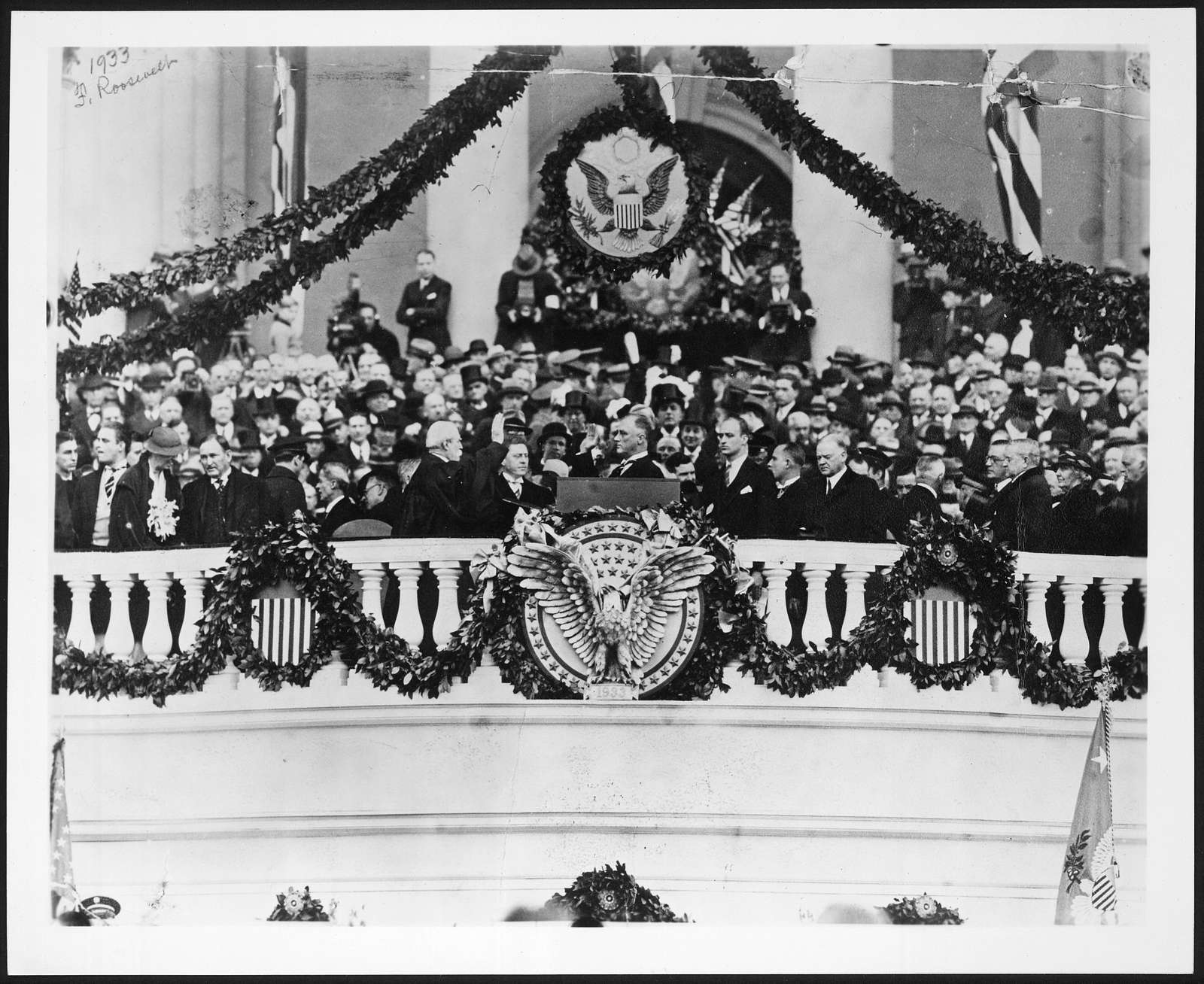 Chief Justice Charles Evans Hughes administering the oath of office to Franklin Delano Roosevelt on the east portico of the U.S. Capitol, March 4, 1933