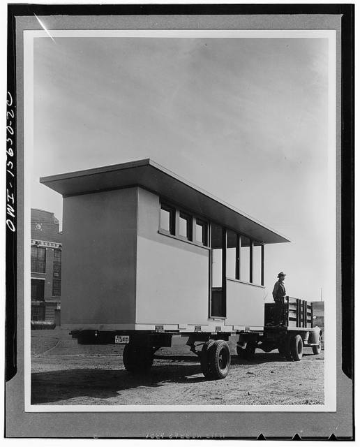 Demountable employee housing. Because many construction projects are in remote localities where the need for housing exists only during the construction period, the TVA (Tennessee Valley Authority) developed over a period of years its own method of prefabrication. Houses, recreation buildings, dormitories, washhouses, etc. have been constructed in three dimensional slices which are transported individually, fully equipped, and are coupled up on the site much like cars of a railroad train. Photograph shows one slice of a cabin, 7 1/2' x 22', in transit