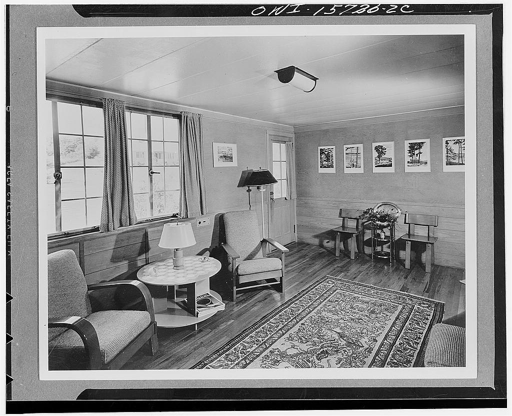 Employee housing. Interior typical of houses at Norris. Floor is of third-grade tongue-and-groove oak which is produced locally. Walls are 7/8 inch tongue-and-groove pine to the window sill level and large sheets of quarter- inch thick fir plywood above. Ceilings are of insulating board. Windows are steel with aluminum screens. Houses are electrically heated; hot water and heating equipment are likewise electrical
