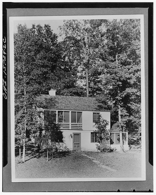 Employee housing. One of the permanent houses in the construction village at Norris. At each project enough types were used to permit taking advantage of site slopes, views, and exposure to breeze. In keeping with the climate all houses have ample screened porches, usually one for dining (as on the lower right) connecting with the kitchen, and one for sitting or sleeping (as the one on the upper floor) connecting with the bedrooms