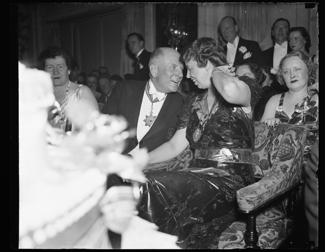 ER [i.e., Eleanor Roosevelt] chatting with man with medal around neck