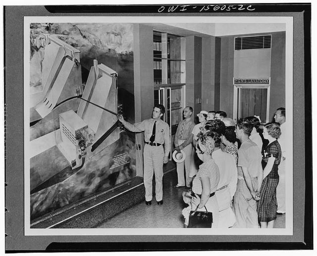 General planning. In the reception room of Norris powerhouse the guide explains to a group of visitors the functioning of the project and will follow up by an explanation of the relation of the particular dam to the integrated system and to the general program of the TVA (Tennessee Valley Authority). See also comments relating to K 1132