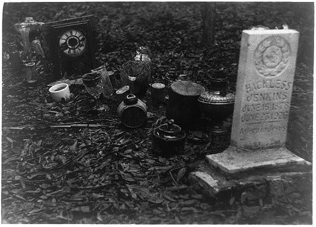 [Grave of Hackless Jenkins, 1878-1928, Sea Islands, Georgia, decorated with clocks, glassware, & other objects]