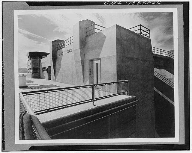 Guntersville Dam and powerhouse. End of spillway deck at navigation lock. Heavy concrete pilings serve as bumpers for gantry deck cranes. Wing houses lock operating machinery and control room