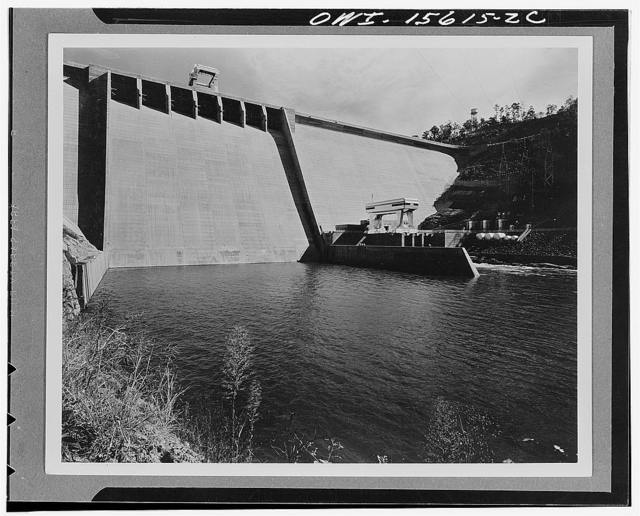 Hiwassee Dam and powerhouse. General view downstream. This dam, about 307 feet high, closes a deep canyon in a scenically outstanding section of the North Carolina Mountains. Keynote of design is extreme simplicity. Highway is carried across top of dam