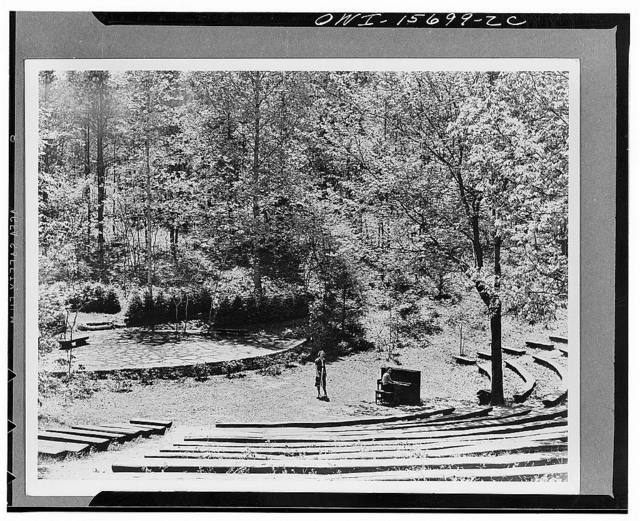 Outdoors ampitheater in Norris Park, close to recreation lodge (see K 749). Split logs serve as benches, stage is paved with local flagstone, thickly planted shrubbery is used for wings and dressing rooms. It is used for informal theatricals, lectures, and meetings