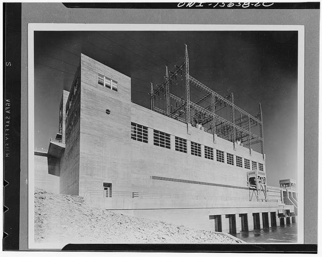 Pickwick Dam. Downstream view of first two units of powerhouse. Intended for an eventual length of six, it has been extended to four units since photograph was taken. Assembly and repair bay surmounted by offices and reception facilities, in left end. Concrete shows ordinary formwork composed of tongue-and-groove boards, whereas most TVA (Tennessee Valley Authority) projects make use of special formwork described in connection with Guntersville powerhouse