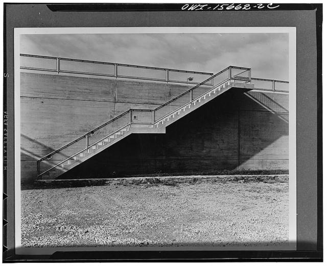 Pickwick Dam. Light concrete stair with galvanized mesh railing on Pickwick project. Note that light comes from flush controllens fixtures recessed into concrete