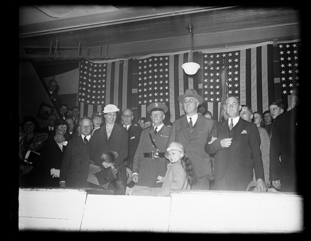 PRESIDENT AND MRS. ROOSEVELT ATTEND SOCIETY CIRCUS AT FORT MYER, VA. FORSAKING AFFAIRS OF STATE FOR THE AFTERNOON, PRESIDENT ROOSEVELT WITH MRS. ROOSEVELT ATTENDED THE SOCIETY CIRCUS AT FORT MYER, VA., TODAY. IN THE CENTER OF PHOTOGRAPH, L TO R: MRS. ROOSEVELT; COL. HARRY N. COOTES, COMMANDANT OF FORT MYER; PRESIDENT ROOSEVELT; AND LITTLE SISTY DALL, GRANDCHILD