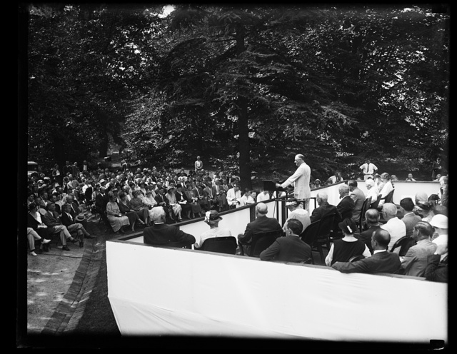 PRESIDENT ROOSEVELT ADDRESSES WELFARE BODY CONFERENCE AT WHITE HOUSE. A TWO DAY CONFERENCE OF THE 1933 MOBILIZATION FOR HUMAN NEEDS OPENED IN WASHINGTON TODAY WHEN PRESIDENT ROOSEVELT ADDRESSED THE GROUP ON THE LAWN OF THE WHITE HOUSE. ON THE PRESIDENT'S RIGHT IN THE PICTURE CAN BE SEEN MRS. ROOSEVELT AND HON. FRANK B. KELLOGG, FORMER SECRETARY OF STATE, WHO RESPONDED TO THE CHIEF EXECUTIVE'S ADDRESS IN THE ABSENCE OF NEWTON D. BAKER, WHO WAS ILL