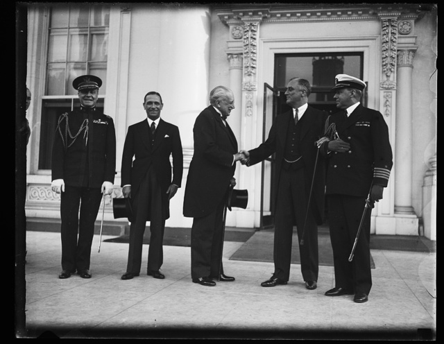 PRESIDENT ROOSEVELT GREETS J.F. ASSIS, BRAZIL DELEGATE TO PRES. ECONOMIC CONFERENCE