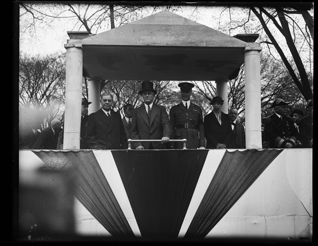 PRESIDENT ROOSEVELT, MRS. ROOSEVELT AND PARTY REVIEW ARMY DAY PARADE. L TO R IN REVIEWING STAND: SECRETARY OF WAR GEORGE H. DERN; PRESIDENT ROOSEVELT; BRIG. GEN. J.A. DELAFIELD; AND MRS. ROOSEVELT