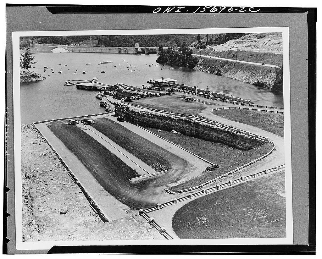 Recreational structures. Boat harbor at Norris, with parking spaces in foreground. Harbor was obtained practically without added expense by application of design to the quarrying operations which furnished the concrete aggregate for the dam. This view, which shows only a portion of the parking space, indicates the tremendous popularity enjoyed by TVA (Tennessee Valley Authority) resorts, all the parking spaces being jammed full on summer holidays
