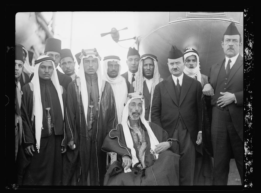 Remains of the late King Feisal. Brought from Europe on a British cruiser. Sept. 14, 1933. King Ali and two sons of Emir Abdullah, etc. Group at the Haifa aerodome from where King Feisal's casket was flown in a R.A.F. plane to Baghdad for burial
