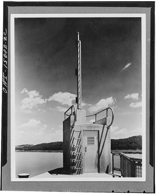 This interesting combination of gauge house and navigation lightpole with service ladders and handrails developed into decorative features is typical of TVA (Tennessee Valley Authority) navigation projects all up and down the river