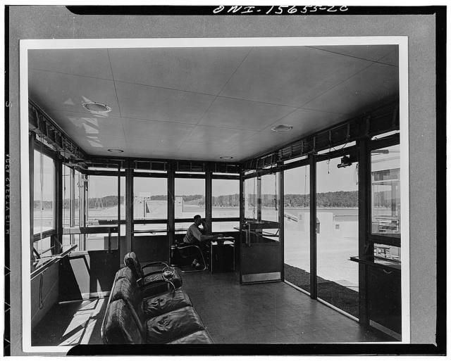Visitors' buildings. Partial view of interior of one of the twin buildings shown on photographs numbers 1986, 1983. This room serves as the guard station and also as reception room where the features of the project and the progress of the TVA (Tennessee Valley Authority) are explained to visitors before they are taken on inspection trips