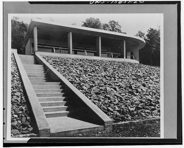 Visitors' builidngs. The visitors' building at Guntersville Dam performs similar functions as described for this type of building at Chickamauga and Pickwick. In addition, it gives access to a landing for pleasure craft through a flight of stairs. It is constructed of brick, like the generator hall across the river