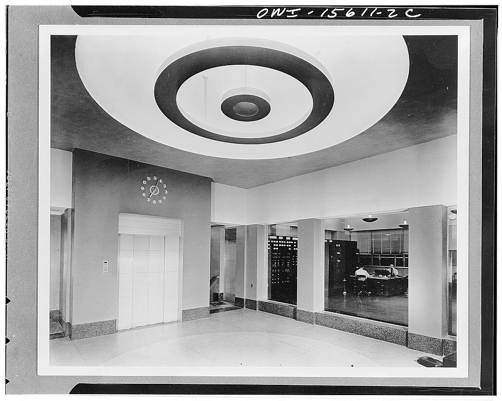Wheeler Dam and powerhouse. Entrance lobby with access to elevator, stairs, toilets, and reception room and with glass panels for viewing control room. Floor is terrazzo, base same material but precast. Walls are plaster but up to the head of the openings covered with burlap to avoid cracks, retain paint better, and for better washability. Ceiling, acoustic plaster. Wheeler dam and powerhouse