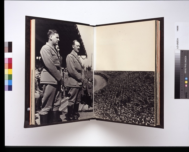 [Adolph Hitler with an official in a stadium at a Nazi party rally and an aerial view of a crowd of people giving the Nazi salute, Nuremberg, Germany]