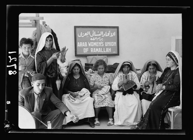 Arab Women's Union of Ramallah. Group at work in the Ramallah work rooms of the A.W.U.R.