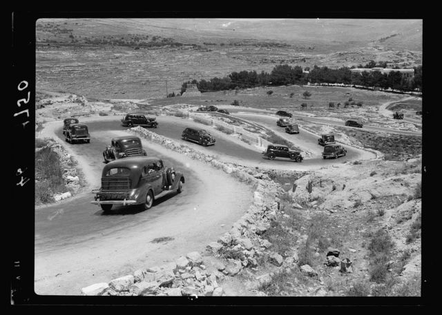 """Castell road """"Seven Sisters"""" S.S. Roina Cruise travelling in train of cars under motor-police escort down the Kastal Hills (Seven Sisters)"""