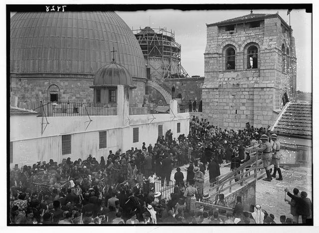 Ceremony of the Holy Fire taking place on the roof of the Greek convent showing domes of the Holy Sepulchre in the background