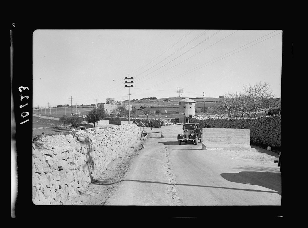 Concrete blocks & tower on Bethlehem road with car threading its way through
