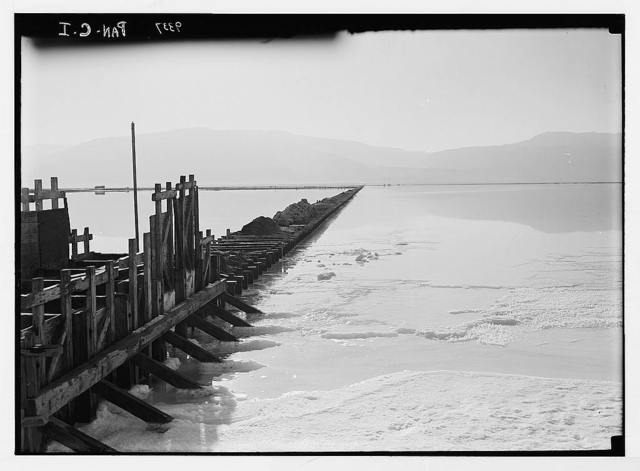 Dead Sea album prepared for the Palestine Potash Ltd. Panoramic view (in two sections) looking E. and S.E. across the wide expanse of evaporating pans in which the eastern mountain range is vividly reflected with effective