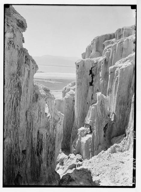 Dead Sea album prepared for the Palestine Potash Ltd. Rock salt formations on the slopes of Jebel Usdum framing a glimpse of the southern end of the Dead Sea